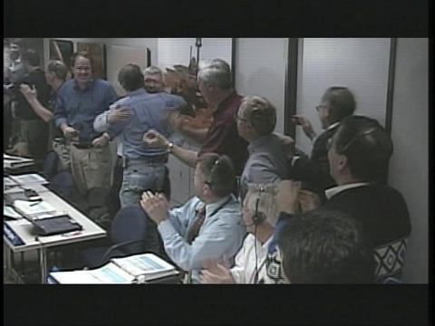 Scientists celebrate in NASA's control room Stock Video Footage