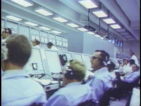 Scientist work in the control room at NASA Footage