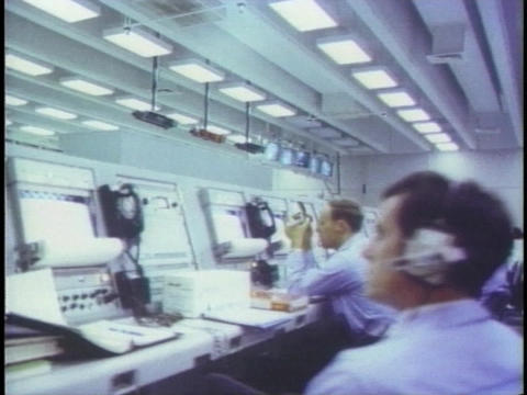 Scientist work in the control room at NASA Stock Video Footage