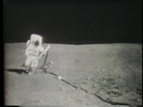 Neil Armstrong walks on the moon Stock Video Footage