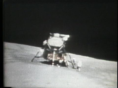 An astronaut runs to the lunar lander Stock Video Footage