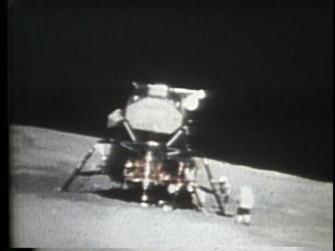 An astronaut runs to the lunar lander Footage