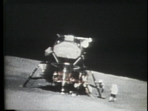 An astronaut runs to the lunar lander Stock Video Footage