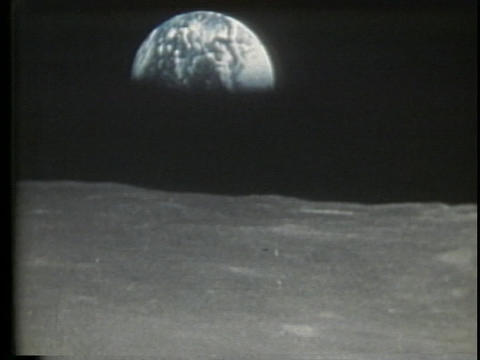 A half Earth shines over the horizon of the moon Footage