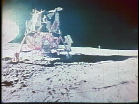 Neil Armstrong hops onto the moon Stock Video Footage