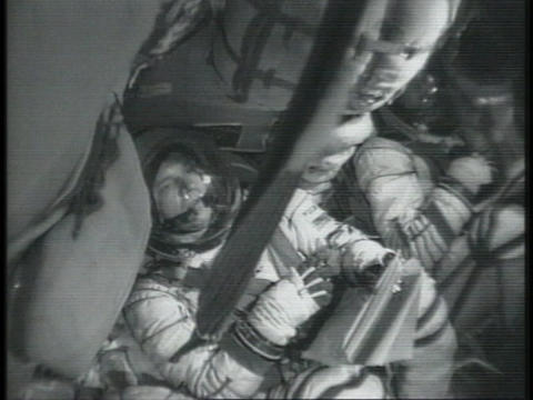 Astronauts sit in the cabin of a spacecraft Live Action