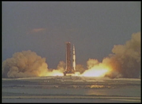 A zoom into a NASA rocket launch from a distant high angle Footage