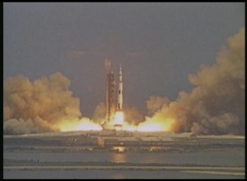 A zoom into a NASA rocket launch from a distant high angle Stock Video Footage