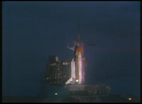 Long-shot of the Space Shuttle in preparation for liftoff at night Footage