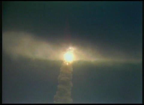 Long shot of the Space Shuttle lifting off through... Stock Video Footage
