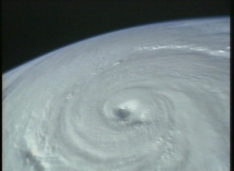 Aerial satellite image of a hurricane cyclone on Earth Stock Video Footage
