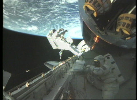 Medium shots of astronauts working on the exterior of... Stock Video Footage
