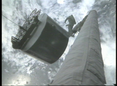 Worms-eye view of an astronaut standing on robotic arm... Stock Video Footage