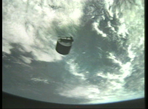 Aerial view of a satellite in orbit with a view of Earth in background Footage