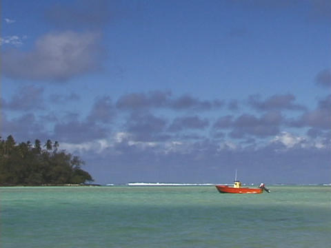 A boat floats on a tropical ocean Stock Video Footage