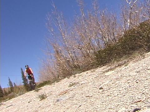 A biker rides across a desert Stock Video Footage