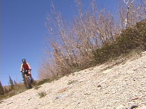 A biker rides across a desert Footage