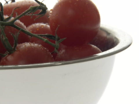 Cherry tomatoes sit in a bowl Footage