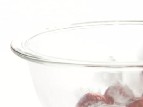 Candies drop into a glass bowl Stock Video Footage