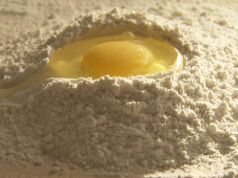 An egg drops into a mixture Footage