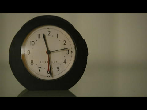 The hands of a clock spin to mark the passing time Footage