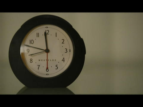 The hands of a clock spin to mark the passing time Stock Video Footage
