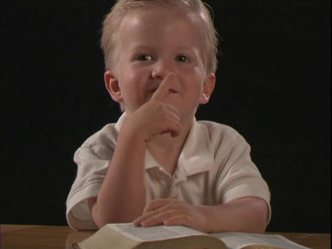 A little boy reads the Bible Stock Video Footage