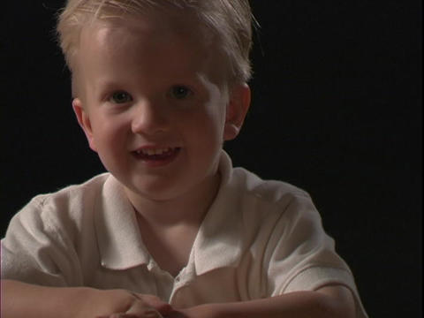 A young boy smiles Stock Video Footage