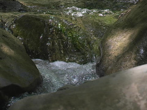 A stream flows over rocks Stock Video Footage