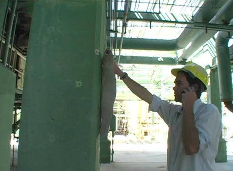 Tracking shot of contractor holding up a blueprint Stock Video Footage
