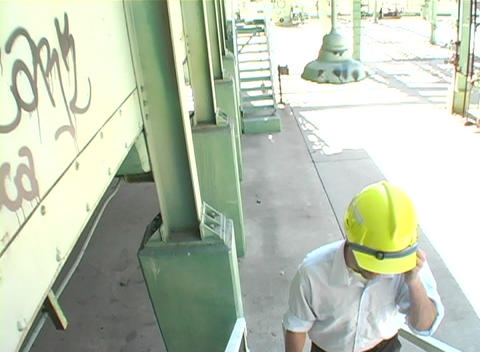 Tracking shot of a contractor walking at construction site Stock Video Footage
