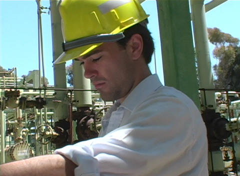 Crab-left of a contractor studying blueprints at... Stock Video Footage
