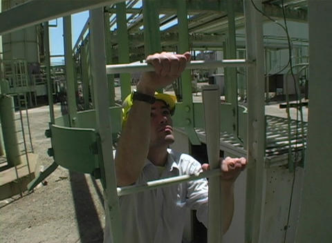 Following shot of a contractor climbing a vertical fixed... Stock Video Footage