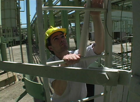 Following shot of a contractor climbing a vertical fixed ladder Footage