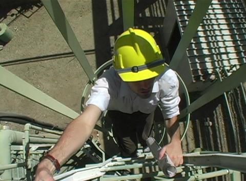 Tracking shot of a contractor climbing a fixed ladder... Stock Video Footage