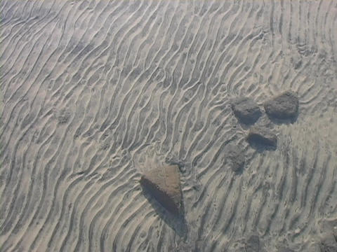 A water pattern is in the sand of a mountain river Footage