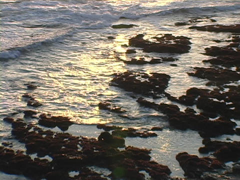 Ocean waves roll onto a rocky coastline Stock Video Footage