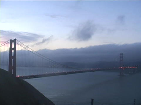 Fog passes over Golden Gate Bridge in San Francisco,... Stock Video Footage