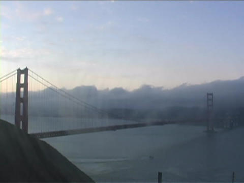 Fog passes over Golden Gate Bridge in San Francisco, California Footage