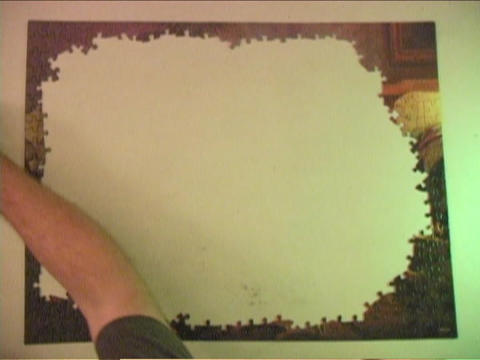 A jigsaw puzzle is put together Stock Video Footage