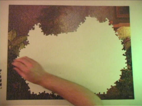 A jigsaw puzzle is put together Footage