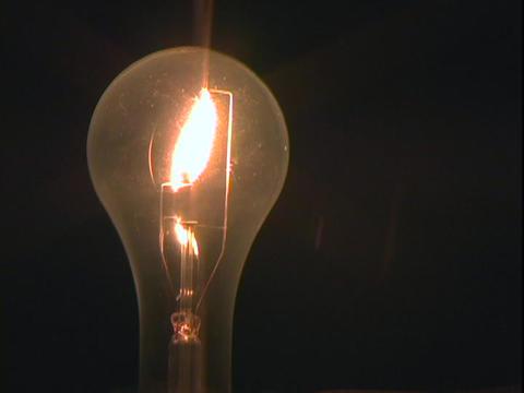 A light bulb is illuminated Footage