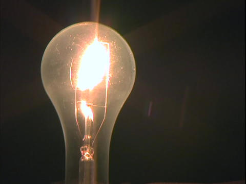 A light bulb is illuminated Stock Video Footage