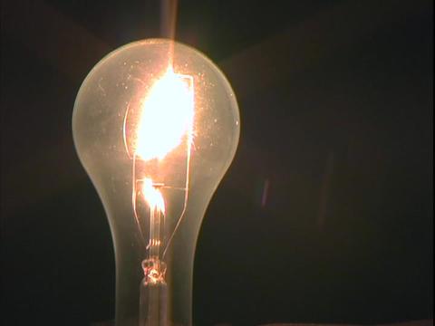 A light bulb is illuminated Stock Video Footage