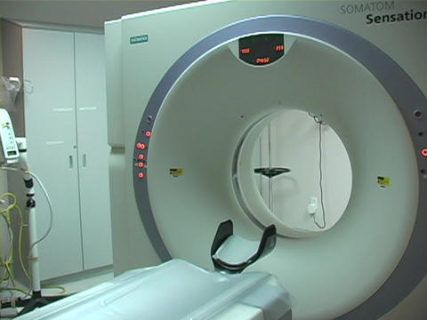 A CAT scan machine is surrounded by medical equipment Stock Video Footage