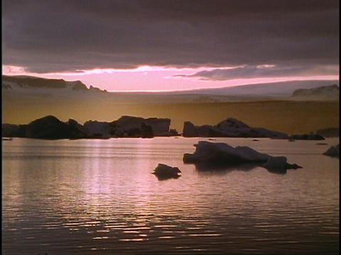 The midnight sun glows on the horizon Stock Video Footage