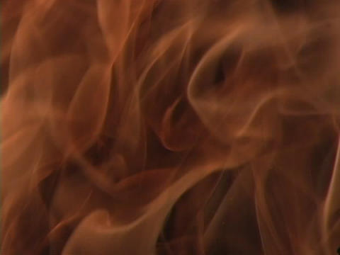 Flames of a fire rise Stock Video Footage