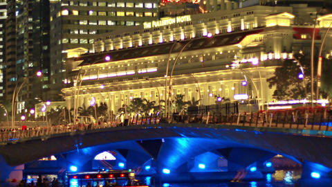 Zoom shot of the beautiful. brightly lit facade of The Fullerton Hotel at night Footage