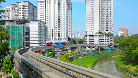 Two monorail trains pass each other going in opposite directions on a bend in do Footage
