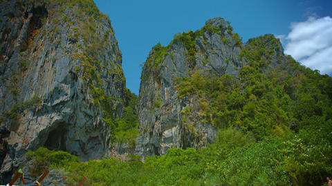 Jagged. towering. limestone crags. topped with sparse vegetation. overlooking th Footage